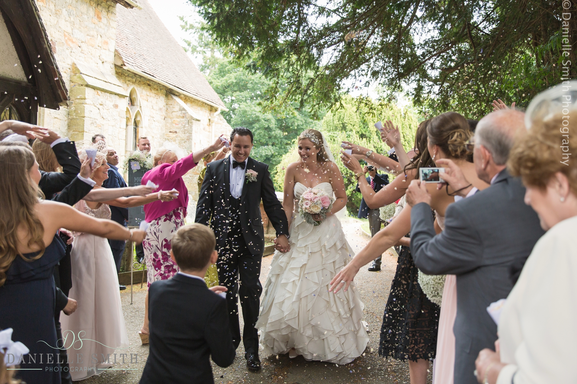 bride and groom confetti photo at Hever church