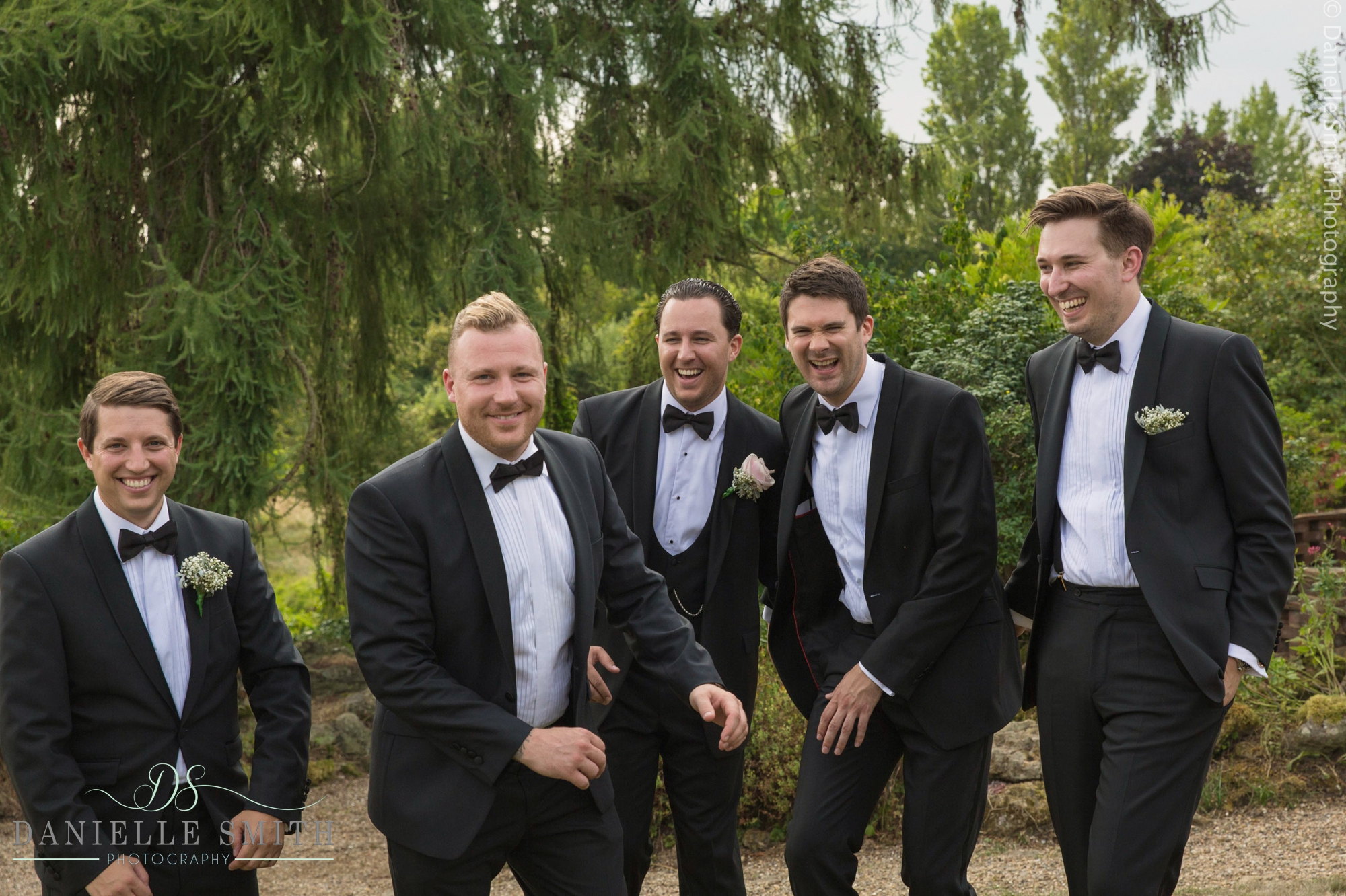 groom and groomsmen messing around - summer garden wedding
