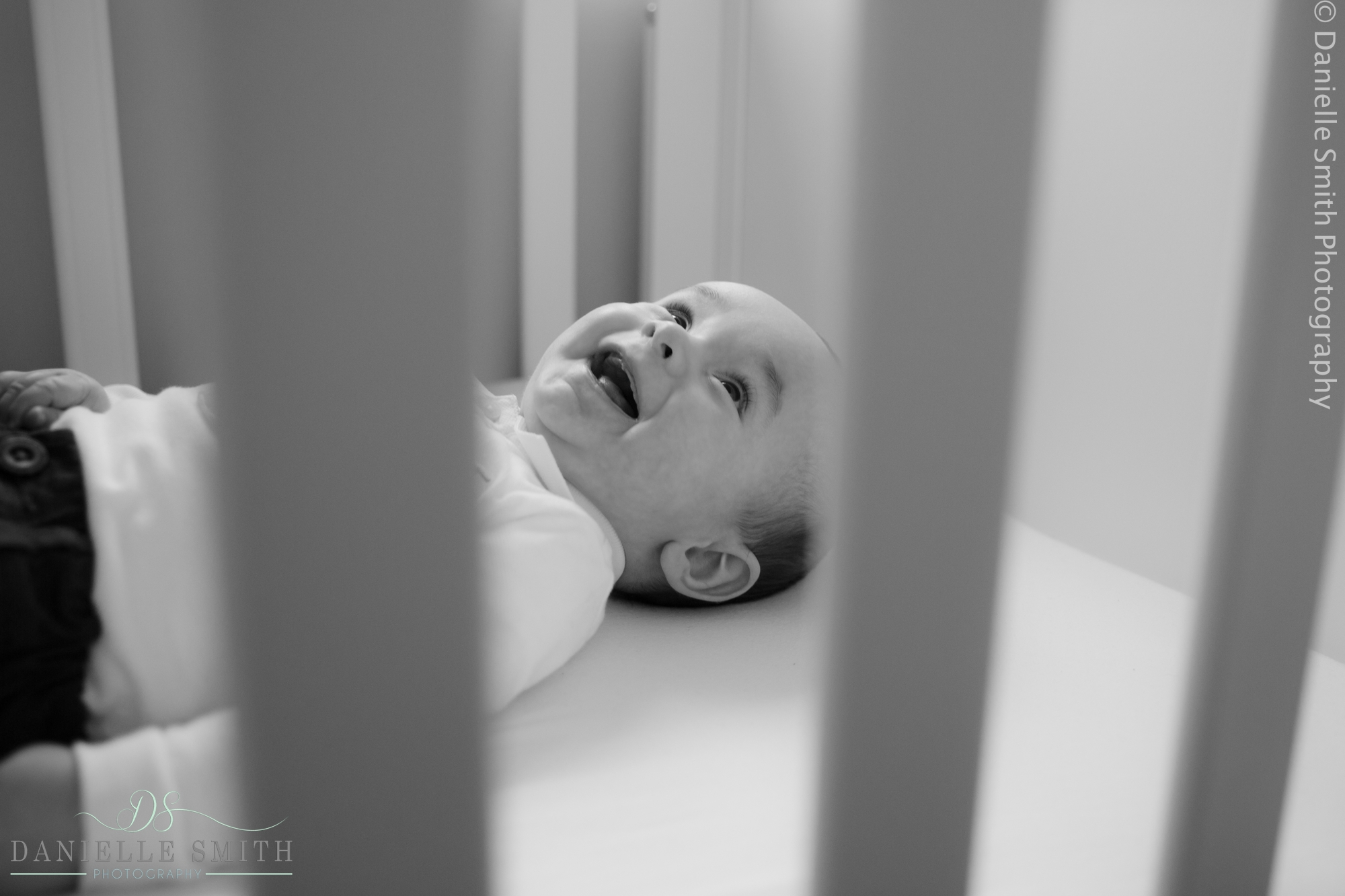 baby boy laughing in cot - mini sessions
