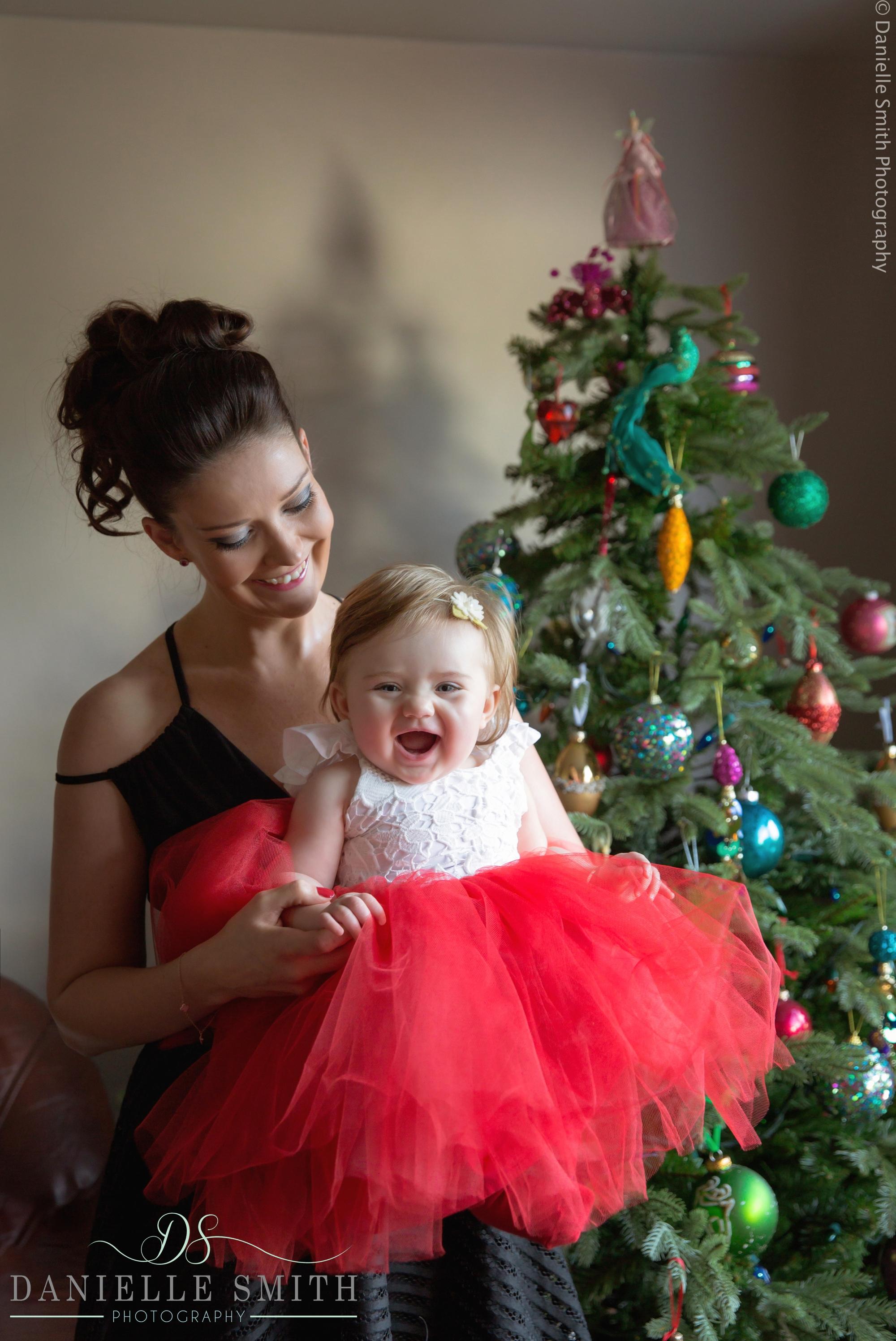 mum holding her little girl at christmas