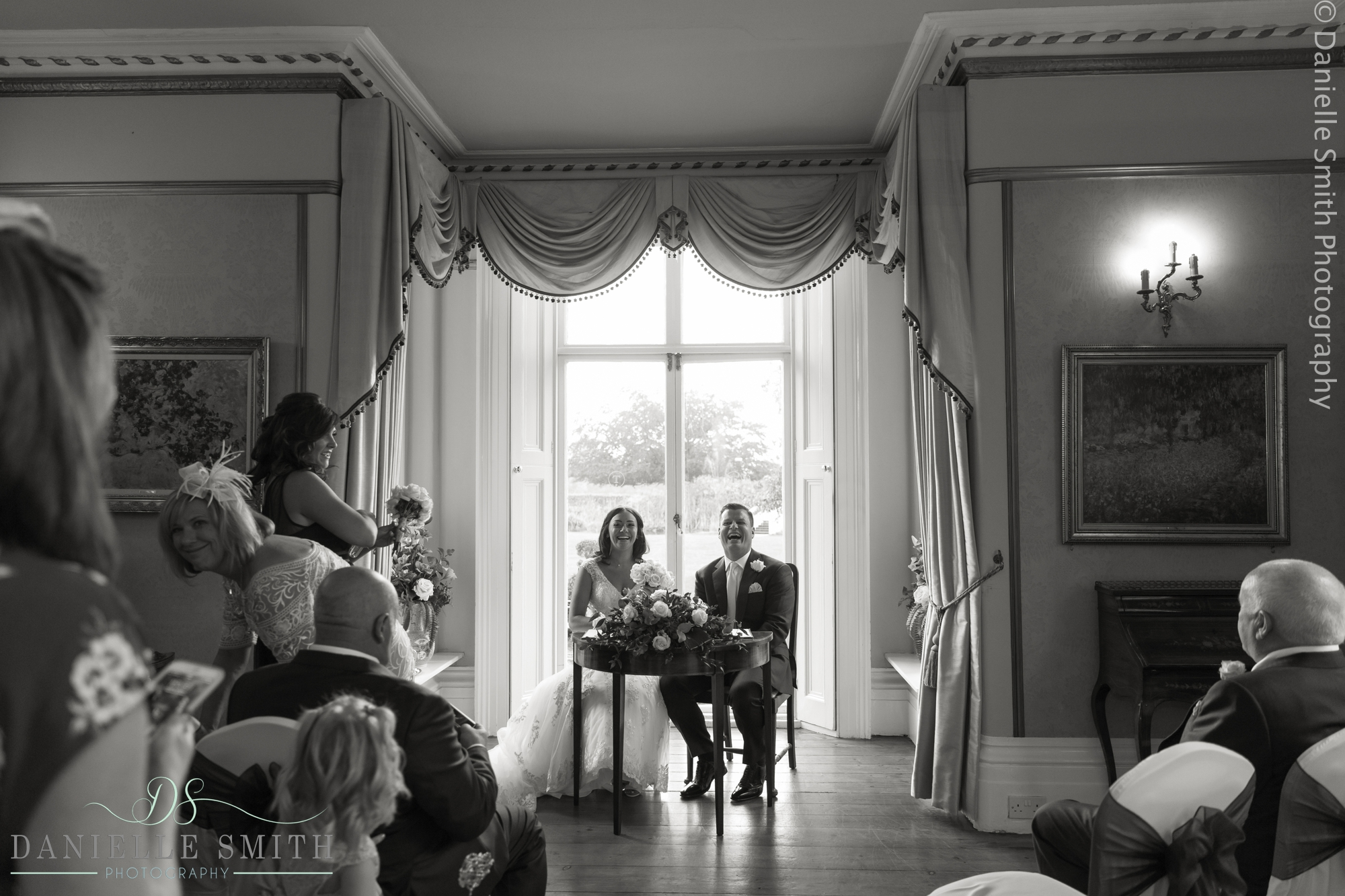 bride and groom laughing at front of ceremony - fennes intimate wedding