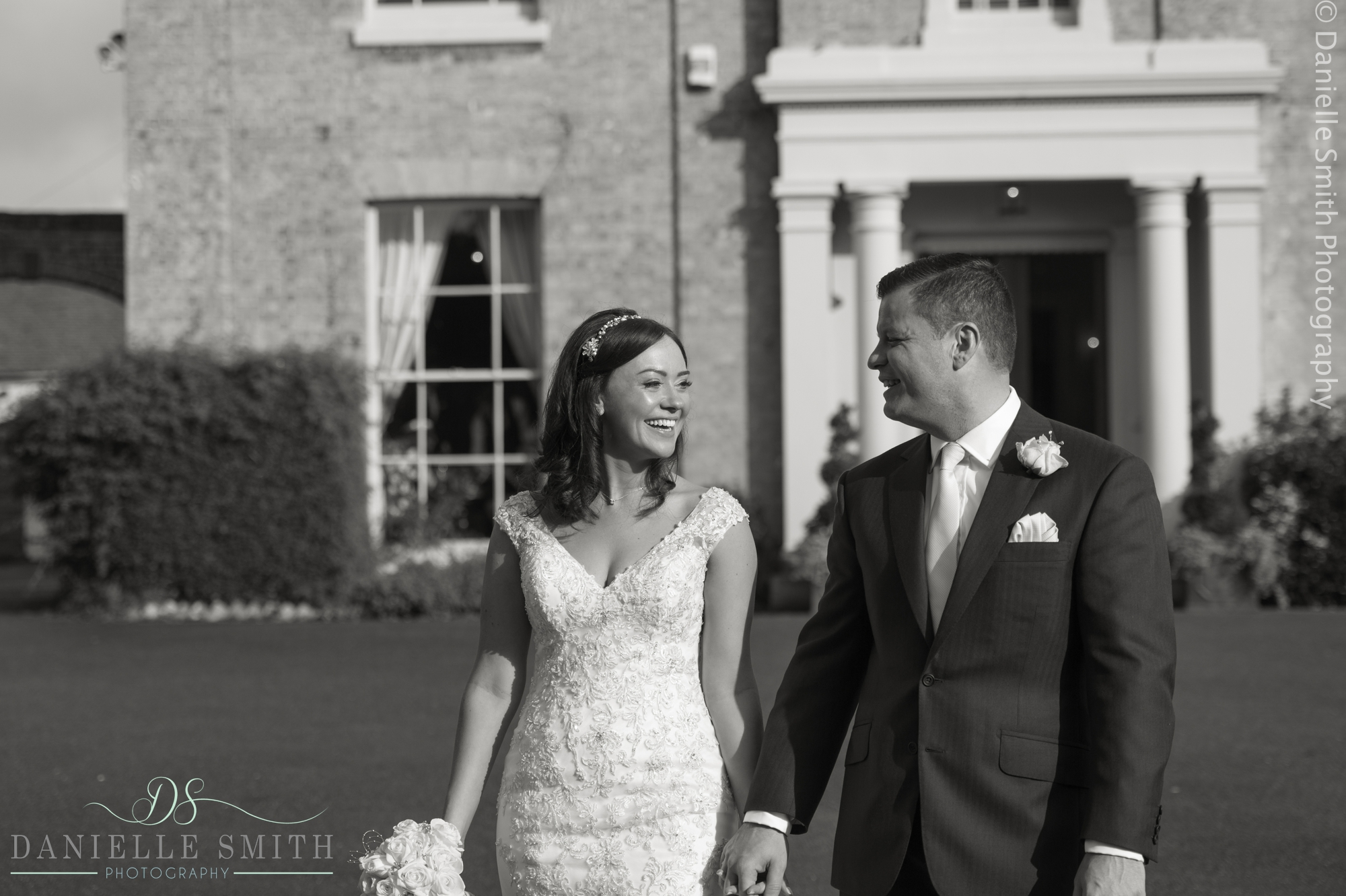 bride and groom smiling at fennes