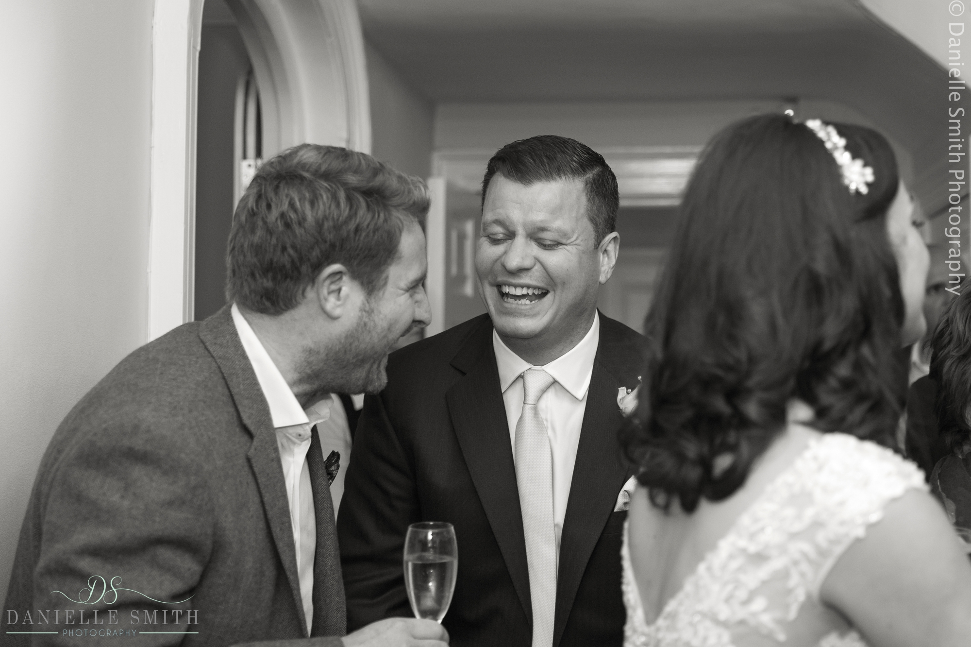 groom laughing with friend