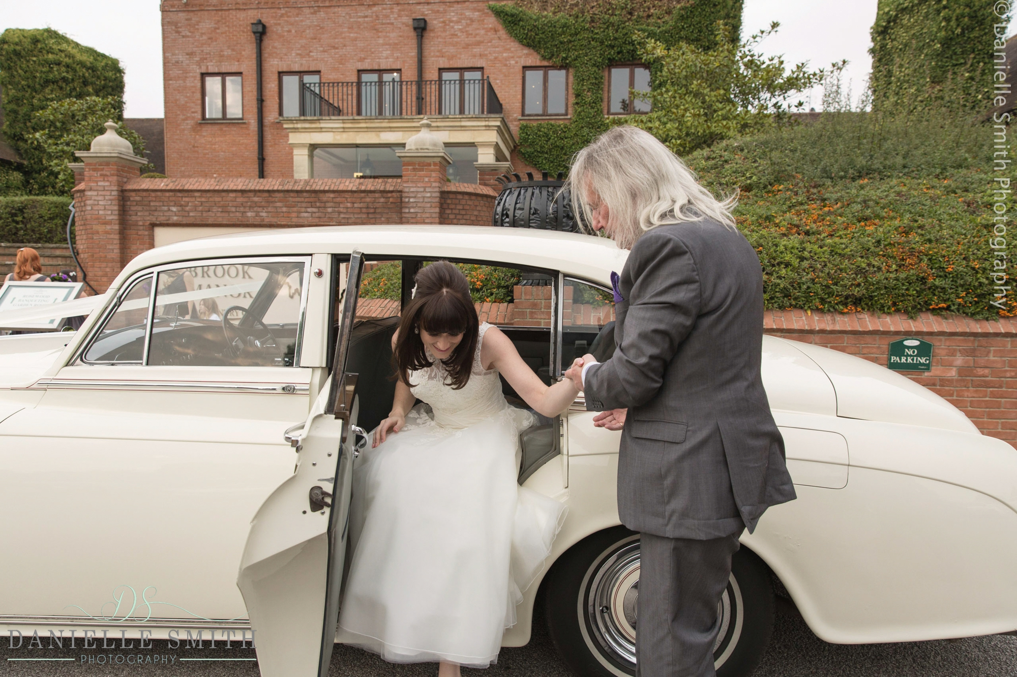 dad helping bride out of car