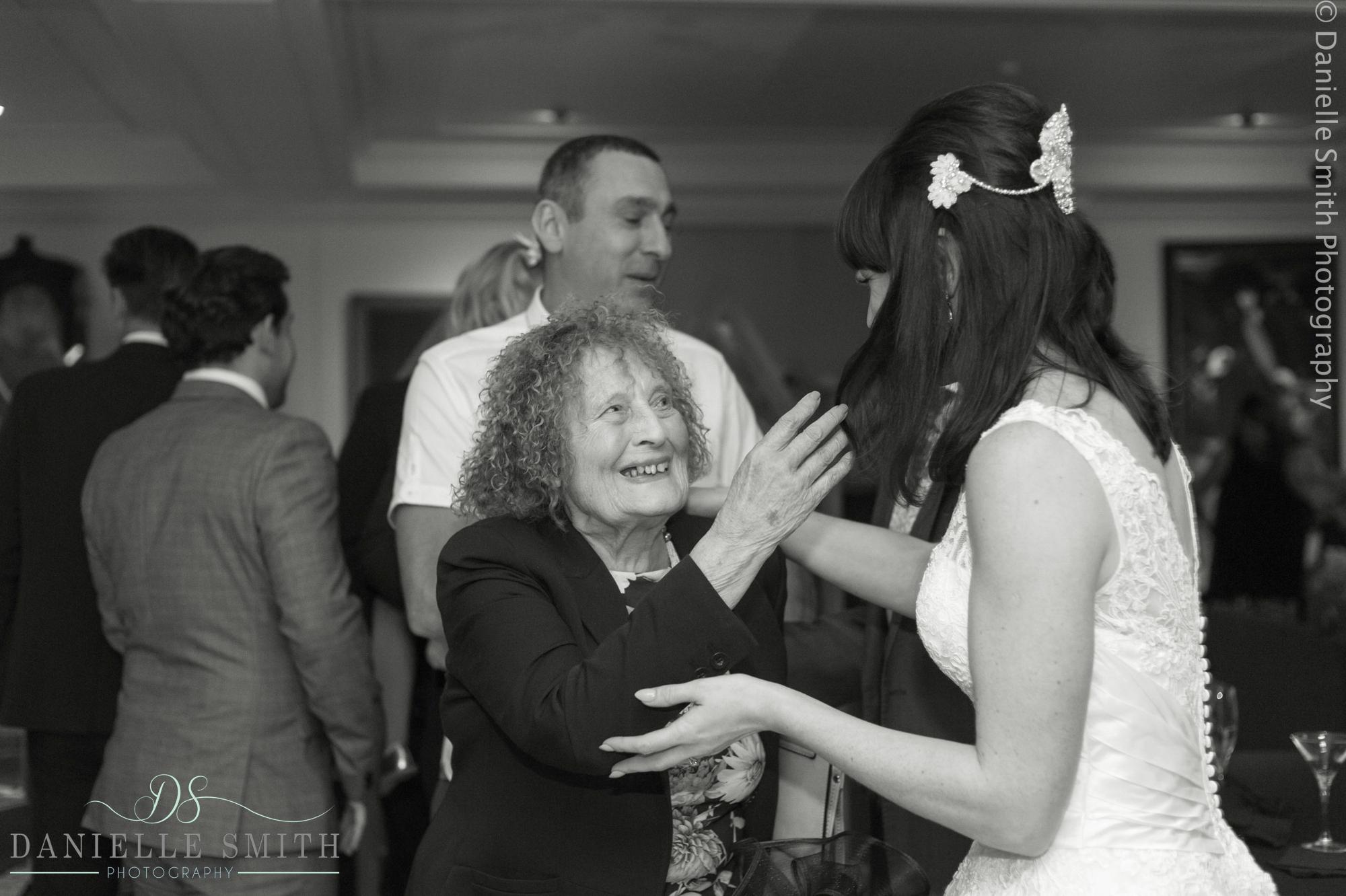 bride greeting older lady