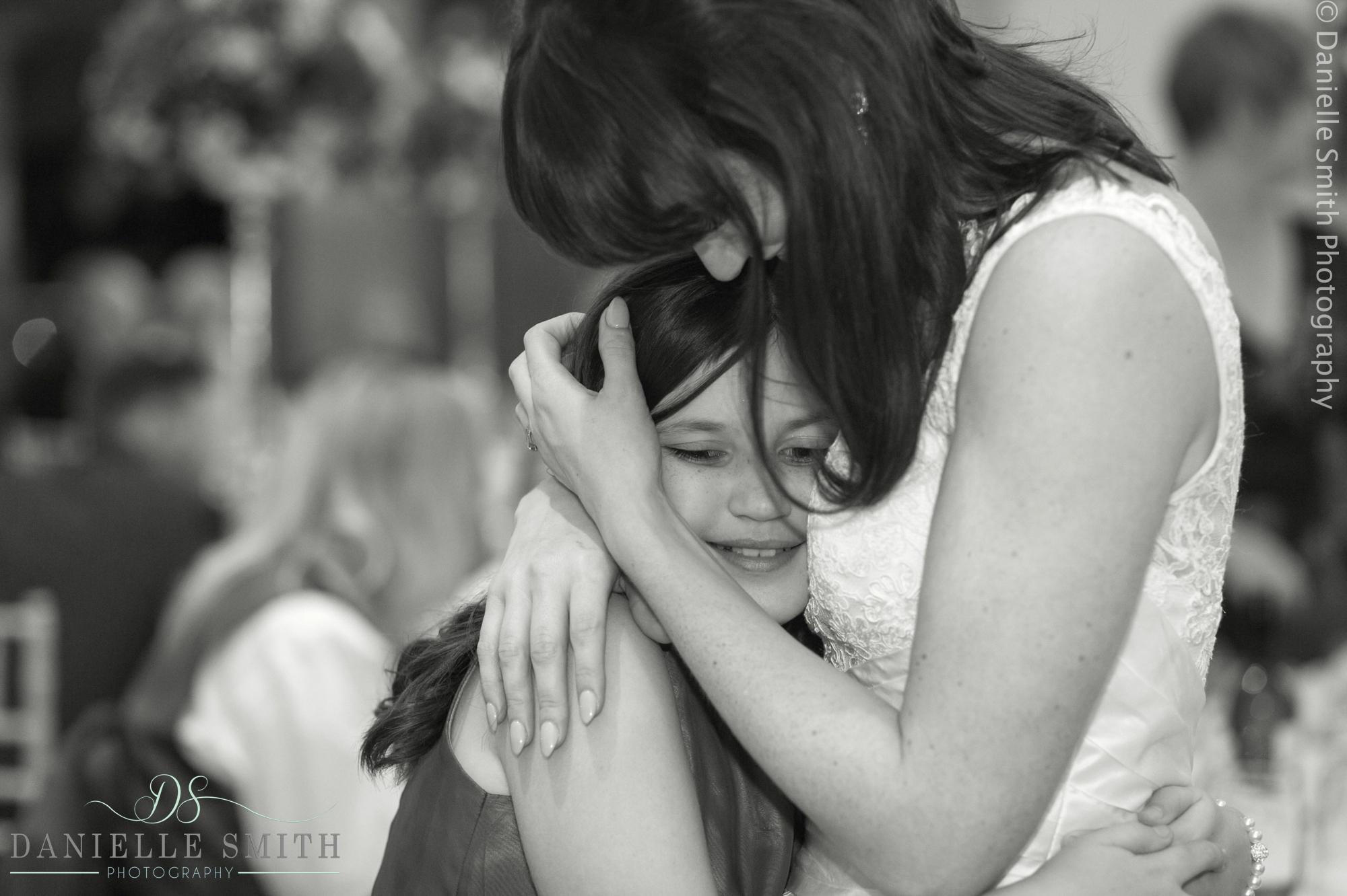 bride hugging flower girl - 1920s style wedding