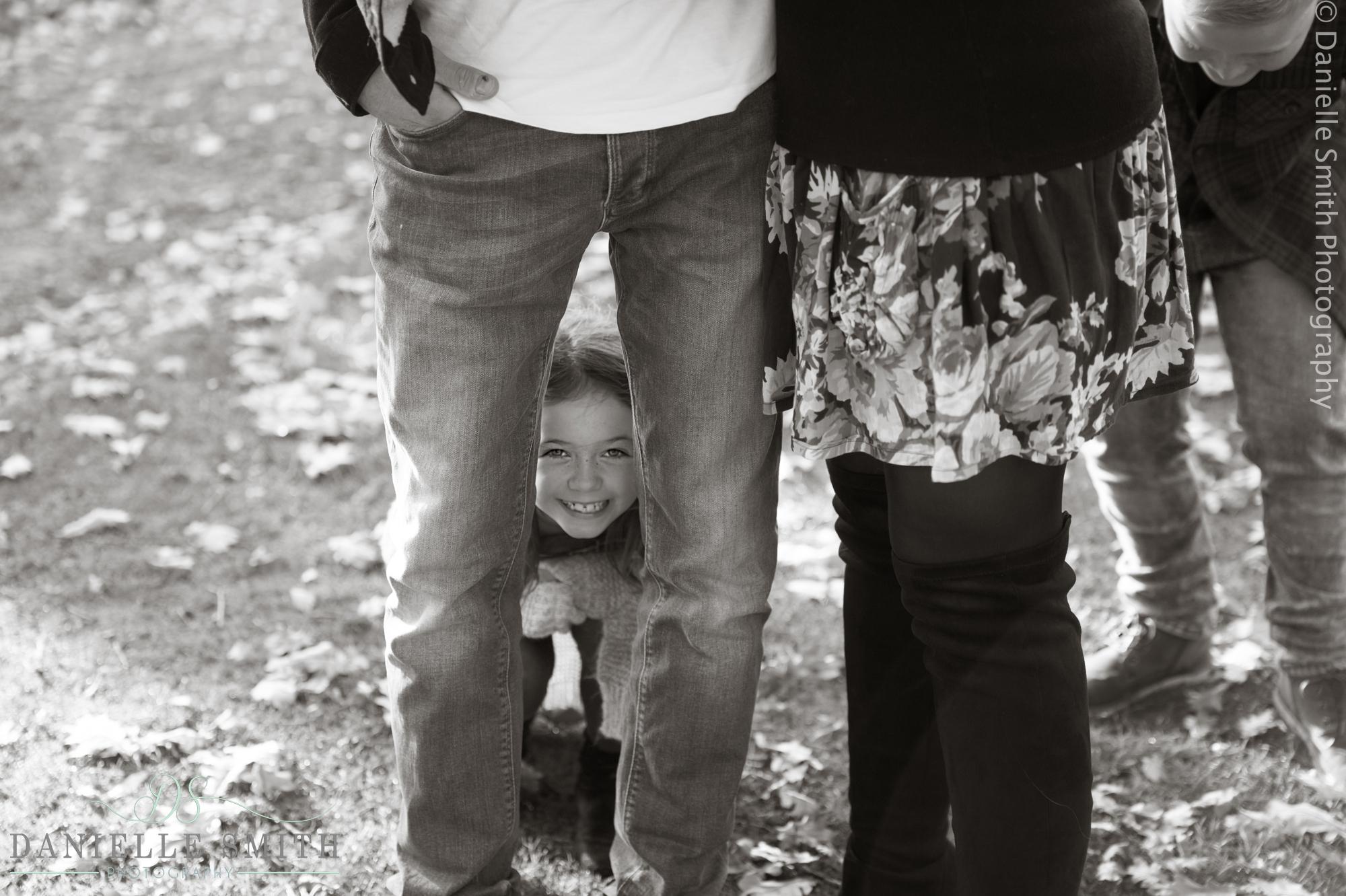 little girl between dads legs