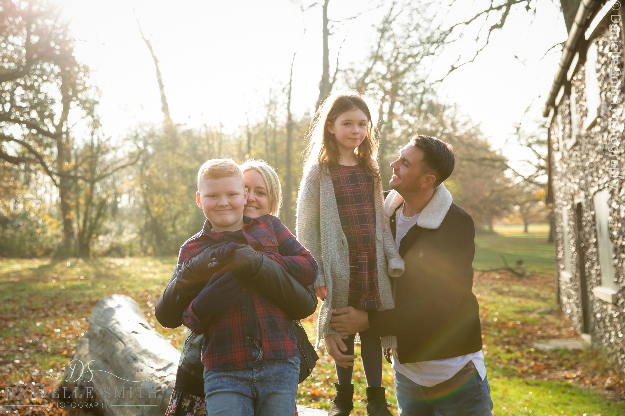 family of 4 in the park at sunset in autumn