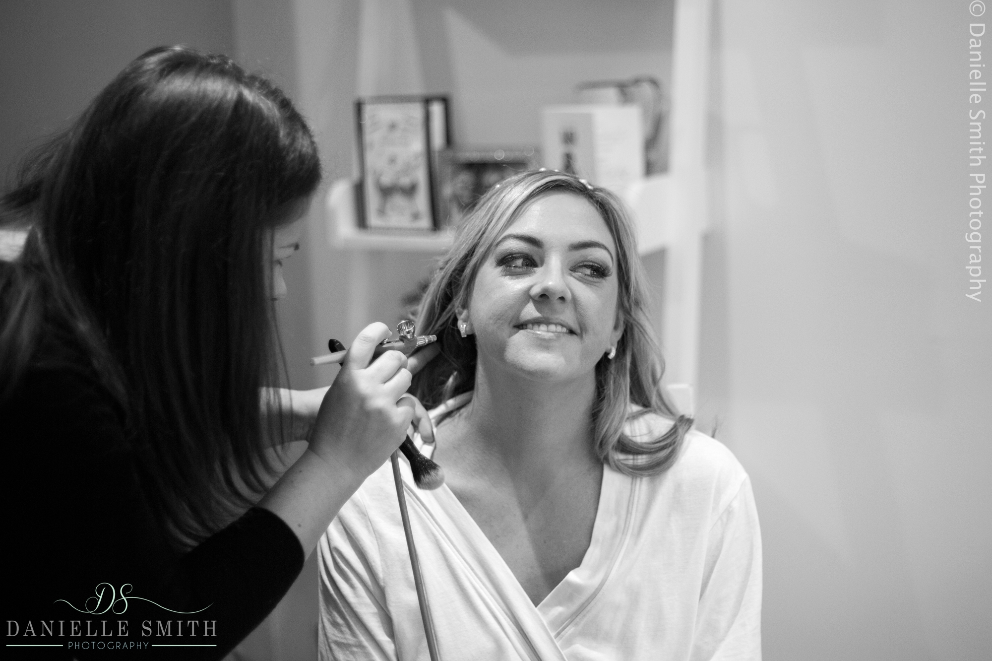 bride having airbrush make up