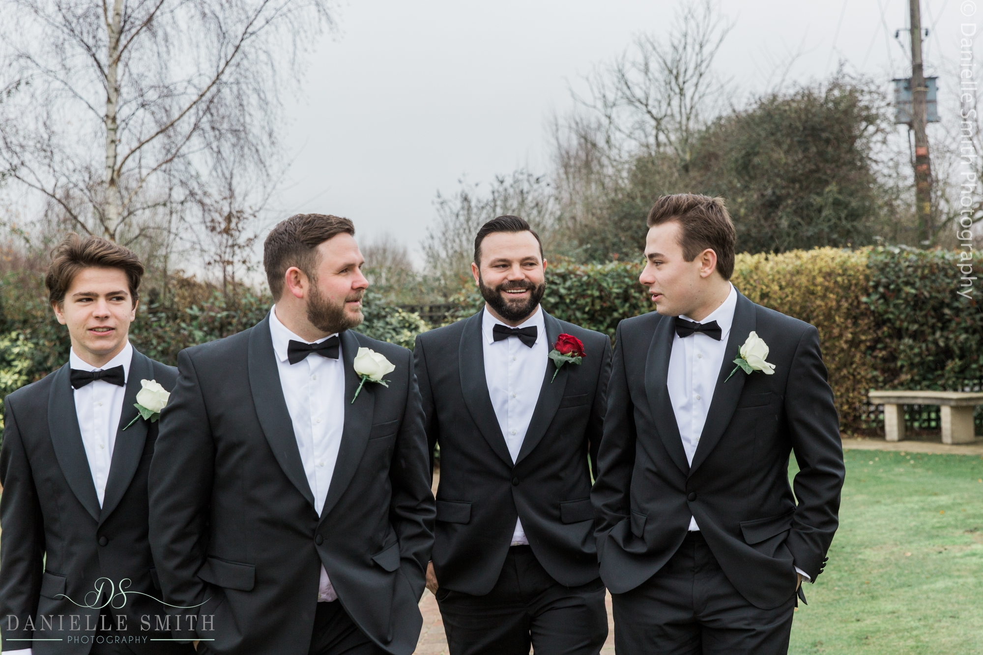 groom and groomsmen in black tuxedos - new years eve wedding