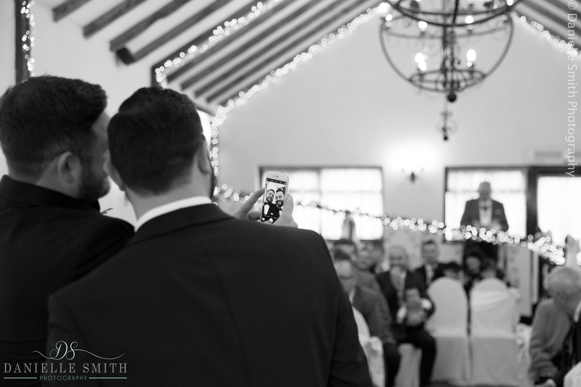 groom and best man having selfie