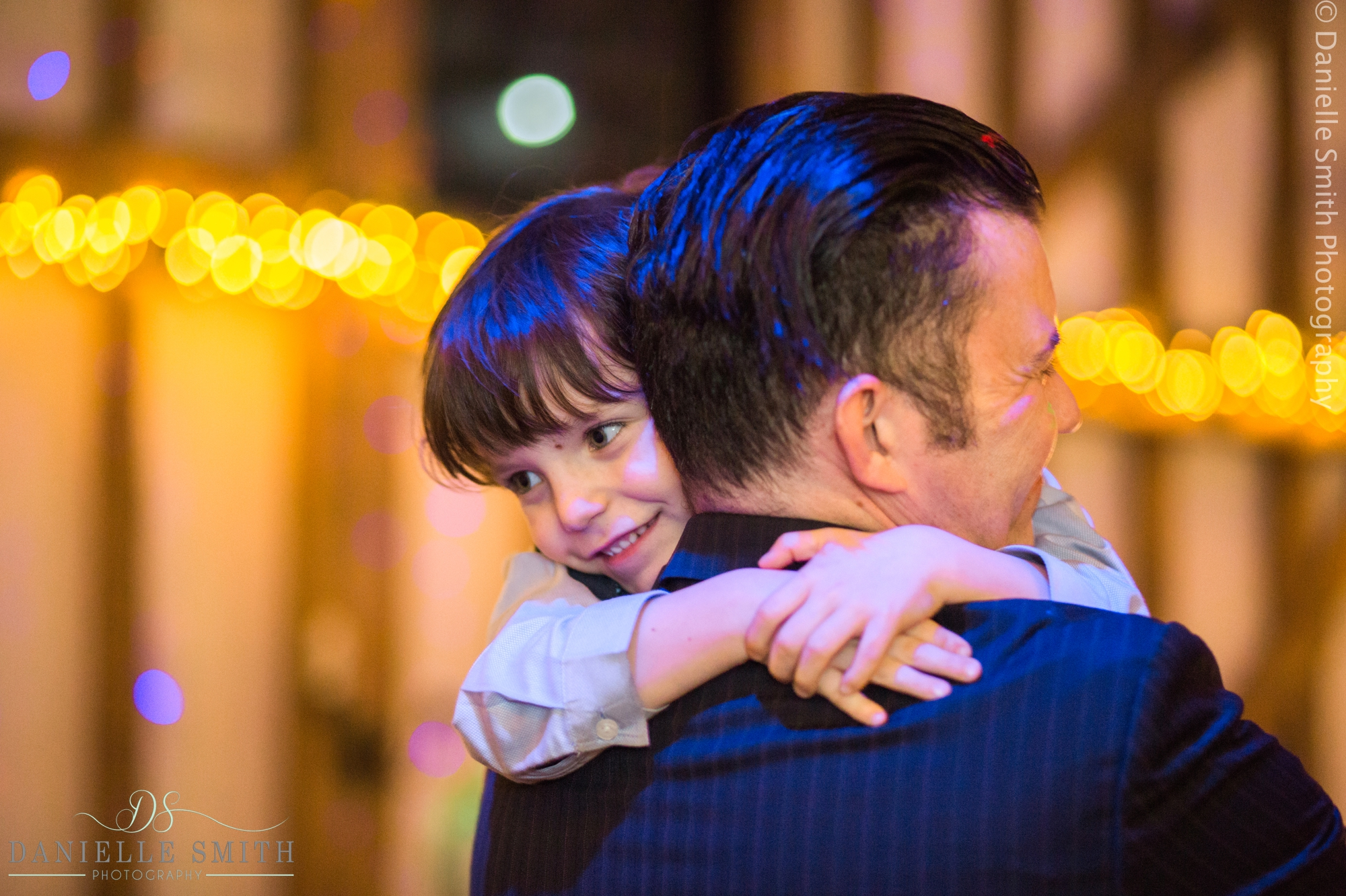 dad hugging son at wedding