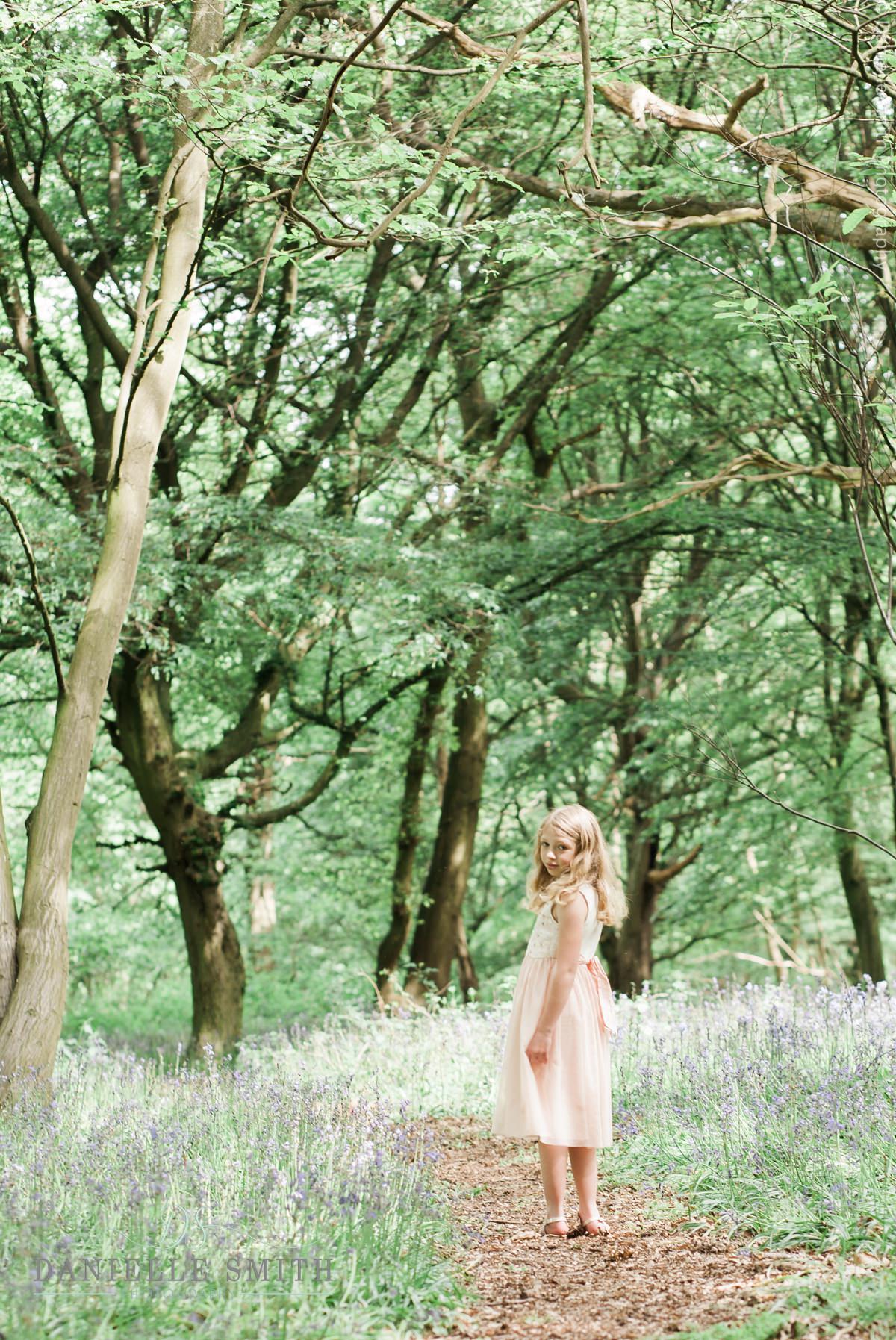 little girl in bluebell woods
