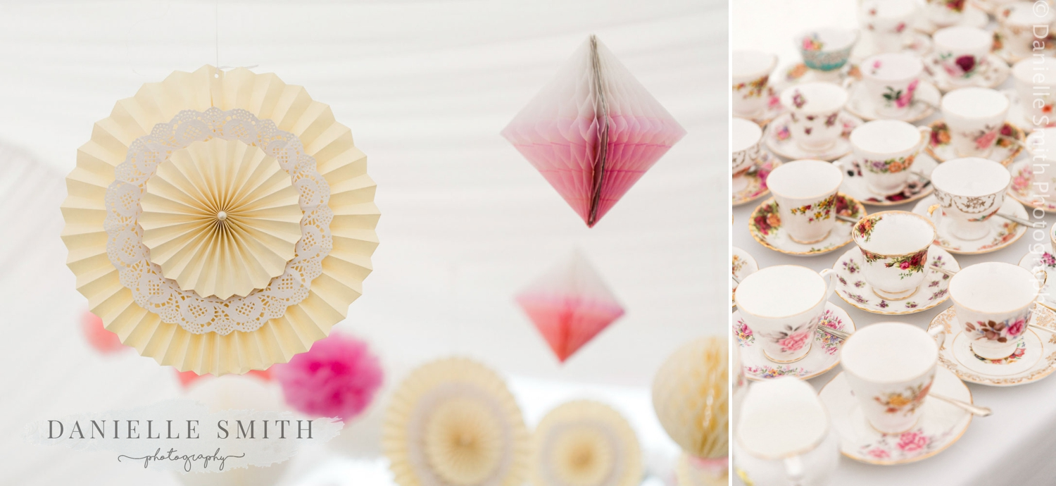 paper decorations at wedding and vintage tea cups