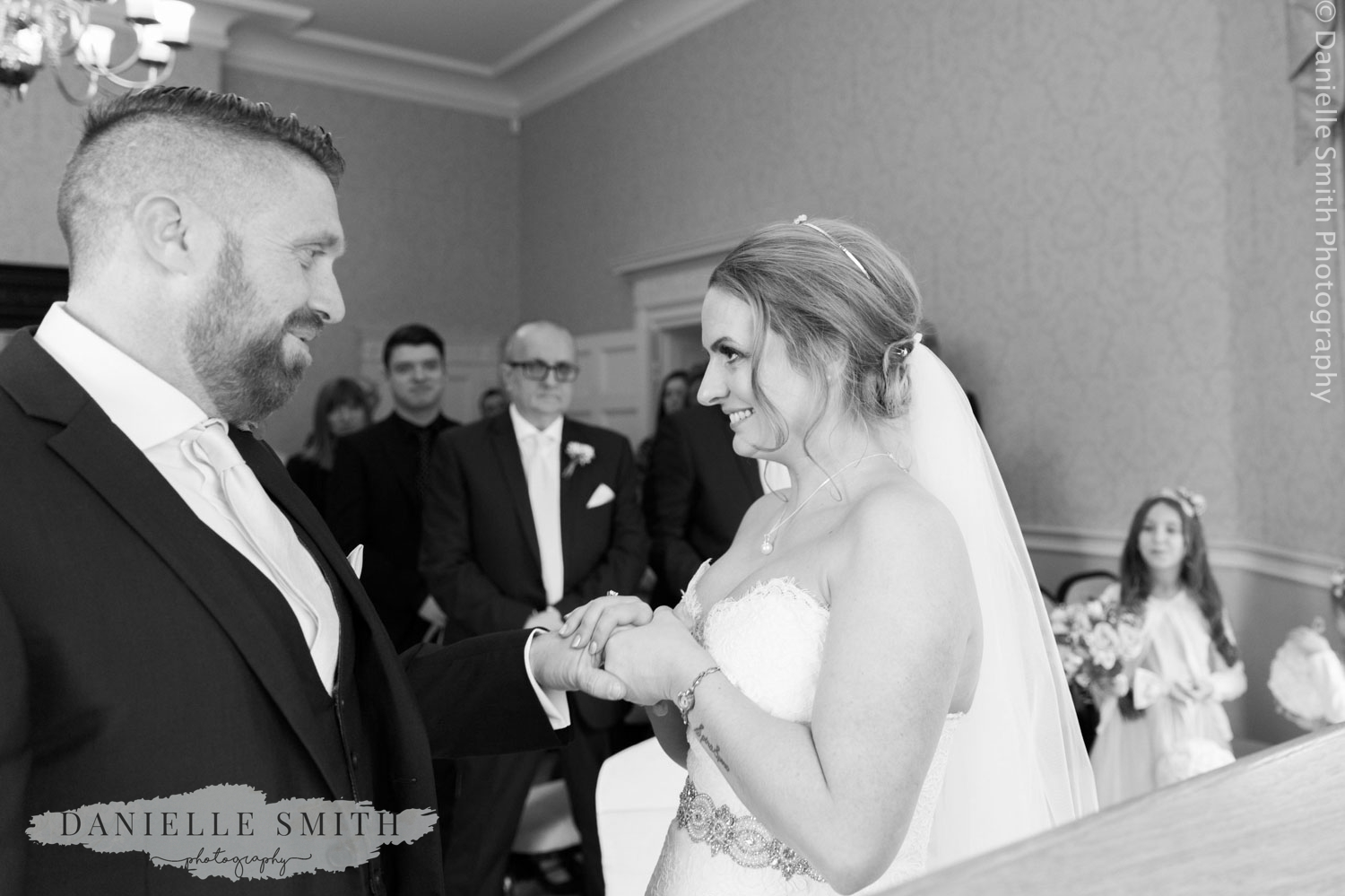 bride and groom exchanging rings at langtons