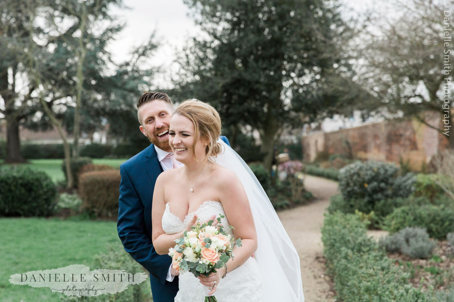 bride and groom laughing at spring wedding at langtons
