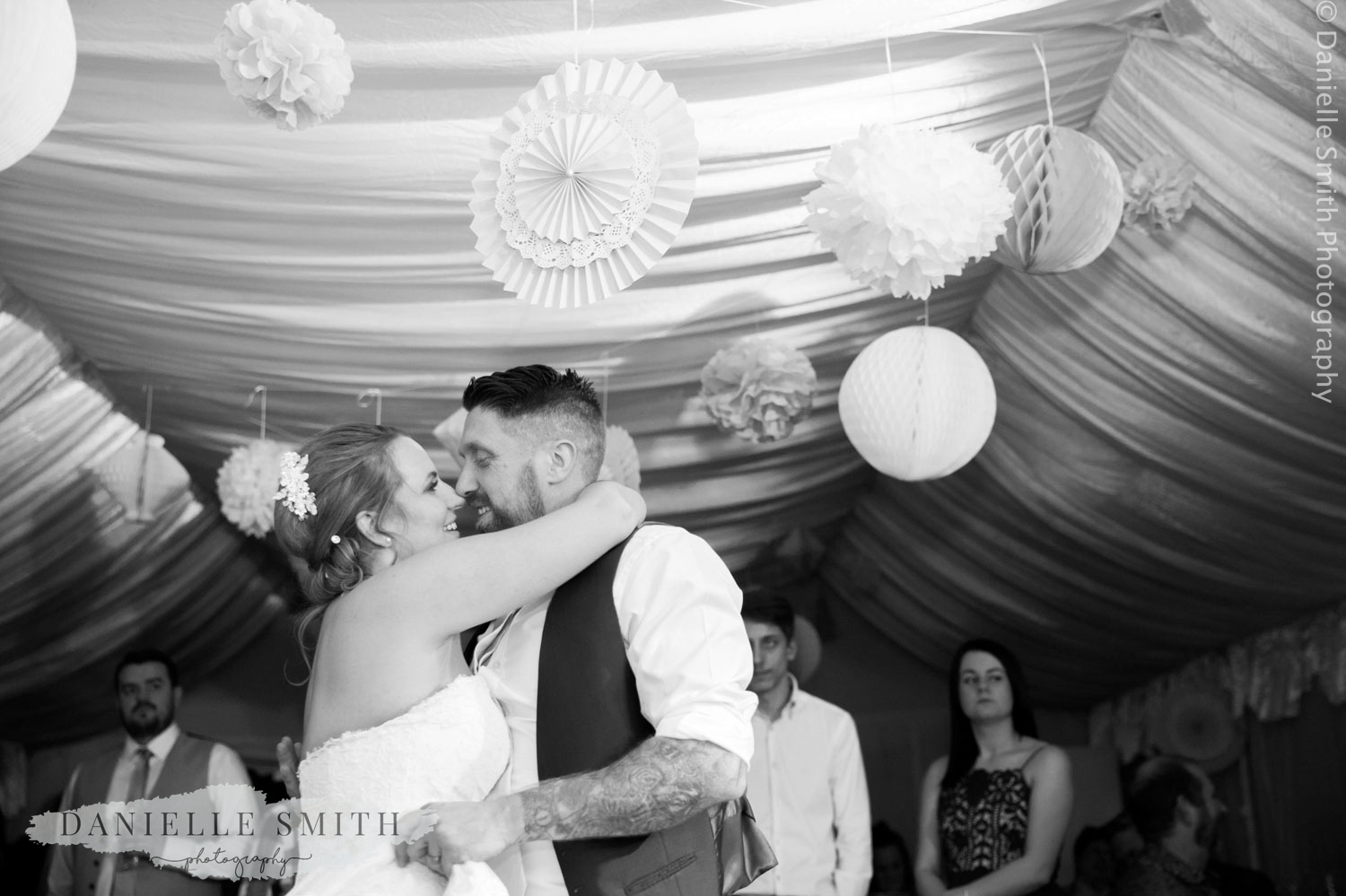 first dance with paper decorations - informal wedding at home