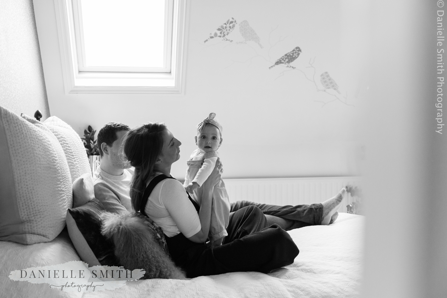 mum and dad with baby girl at home - natural family photos