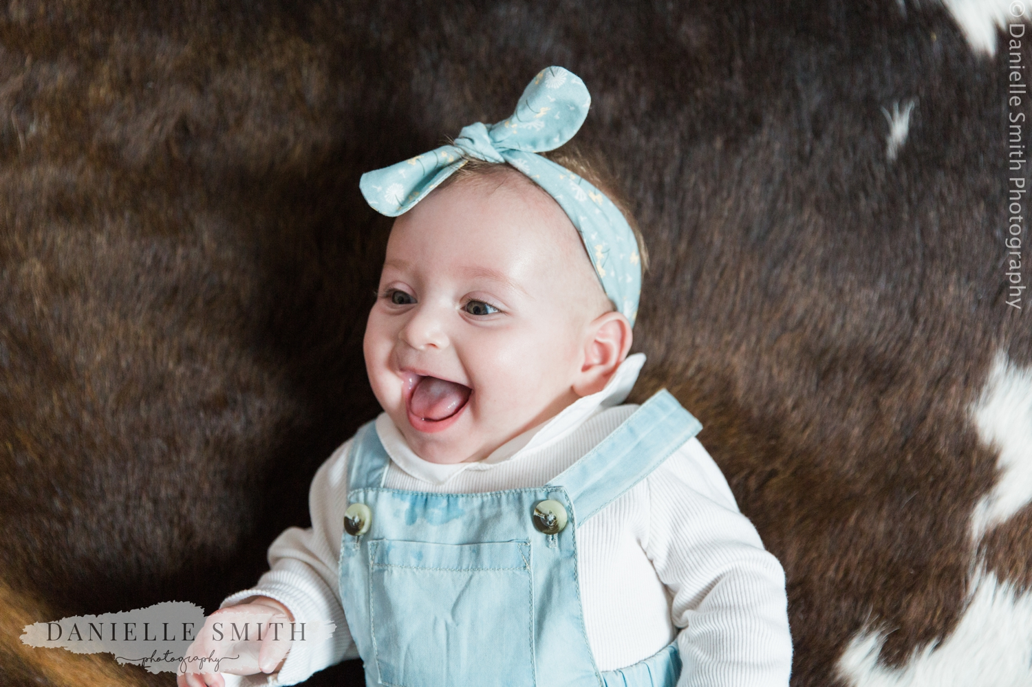 baby girl laughing - natural family photos