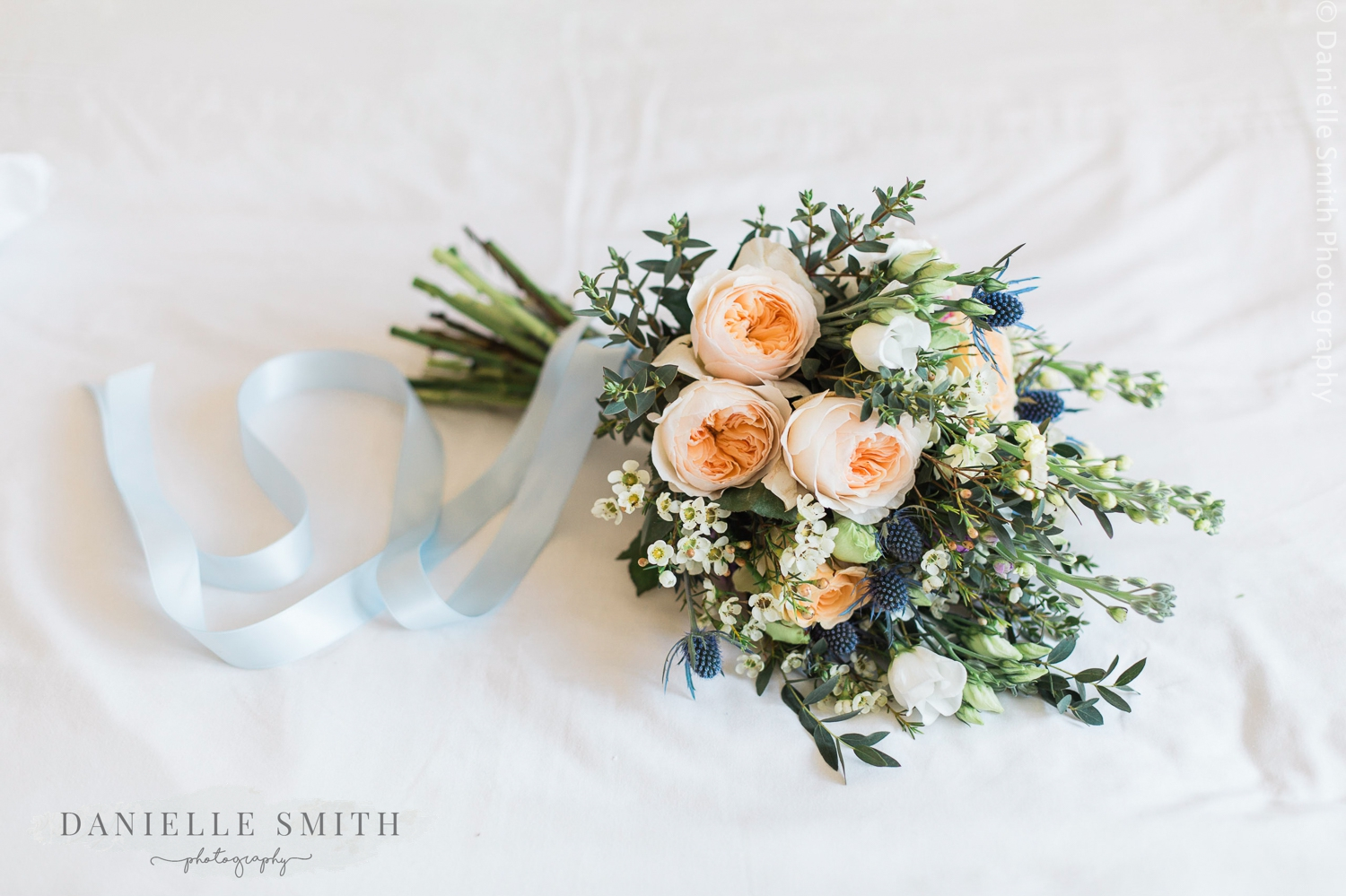 spring pastel coloured wedding bouquet with ribbon