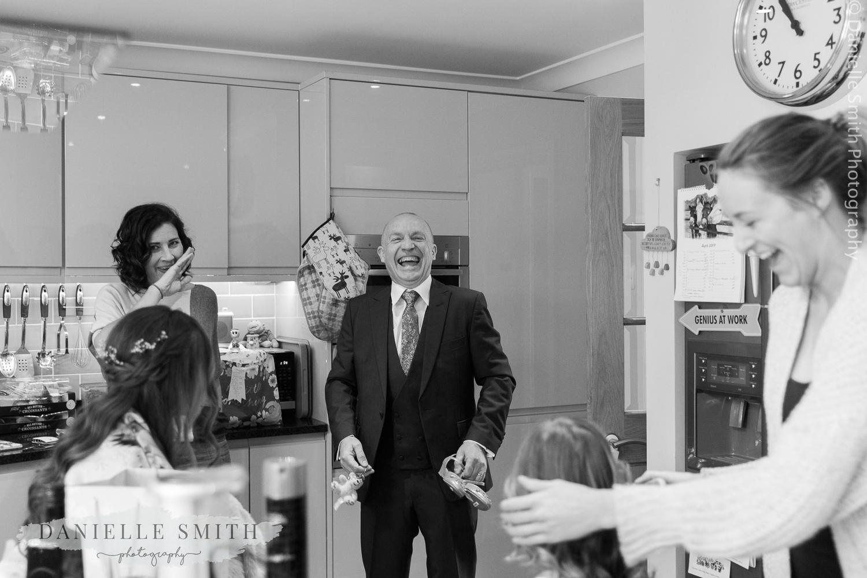 dad laughing during bridal preparations