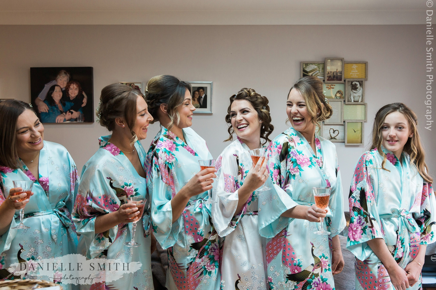 bridesmaids laughing in their dressing gowns