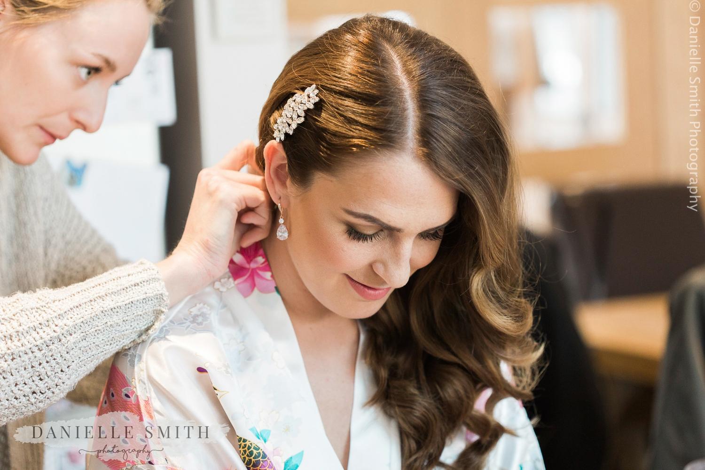 bride having hair pinned