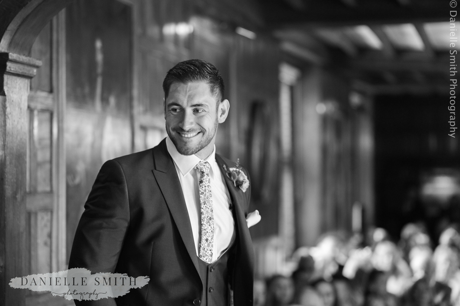 groom waiting for his bride at the aisle