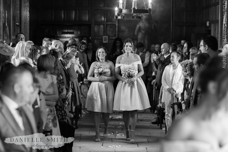 bridesmaids walking down the aisle at ingatestone hall