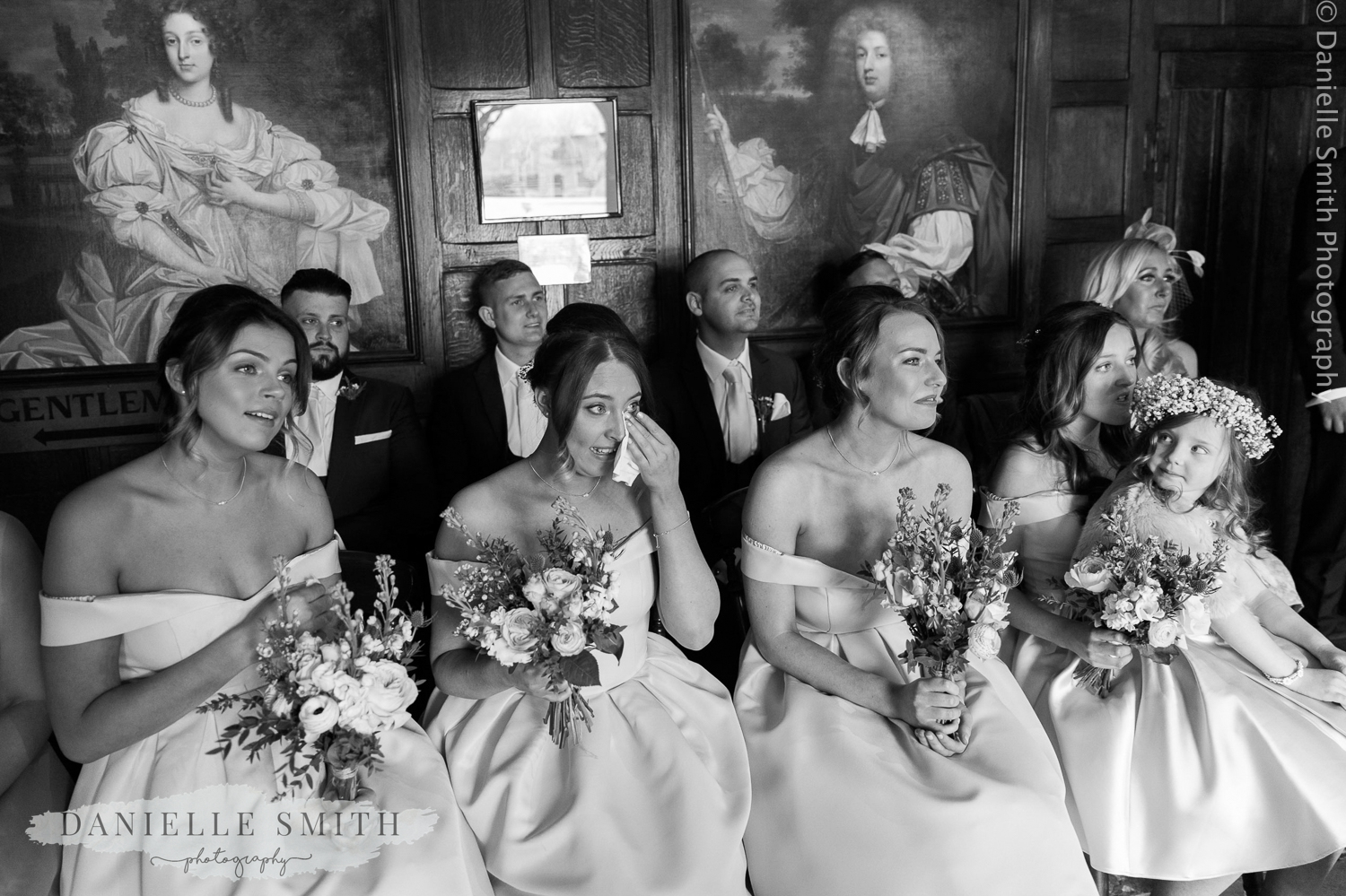 bridesmaids crying during wedding ceremony