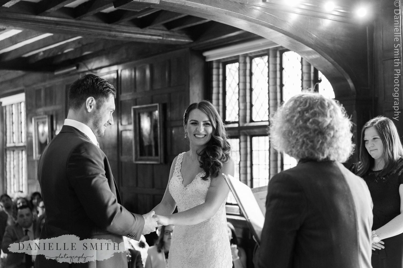 bride smiling during ceremony
