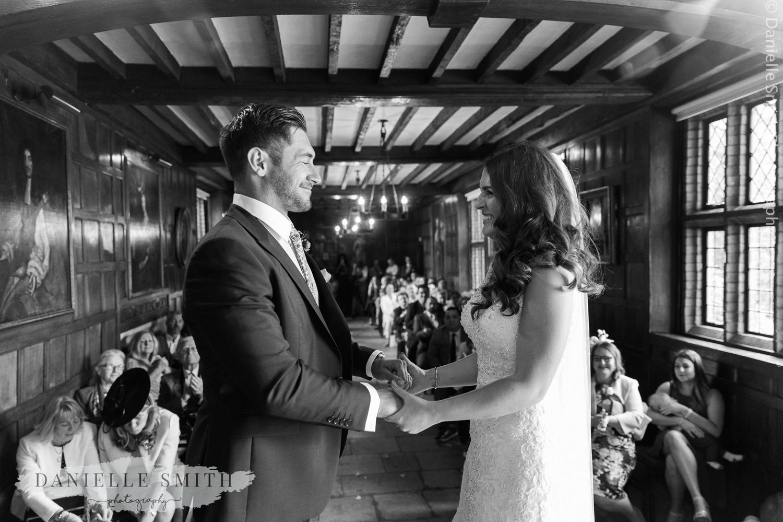 bride and groom tying the knot - ingatestone hall wedding