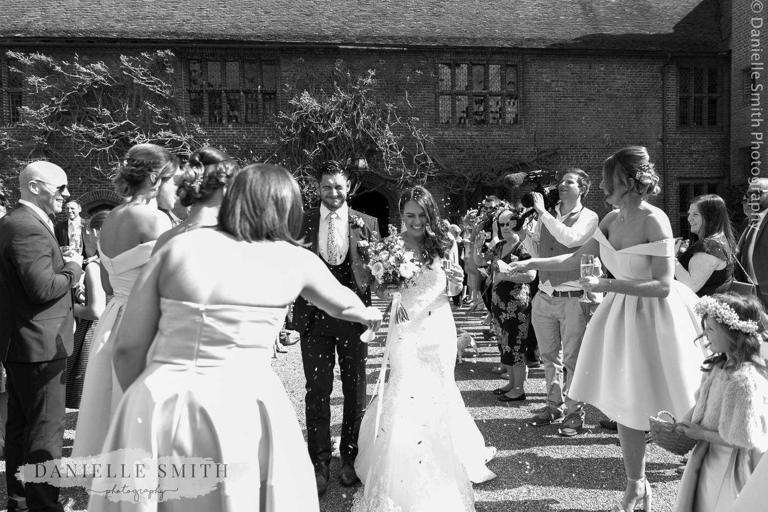bride and groom walk through guests with confetti