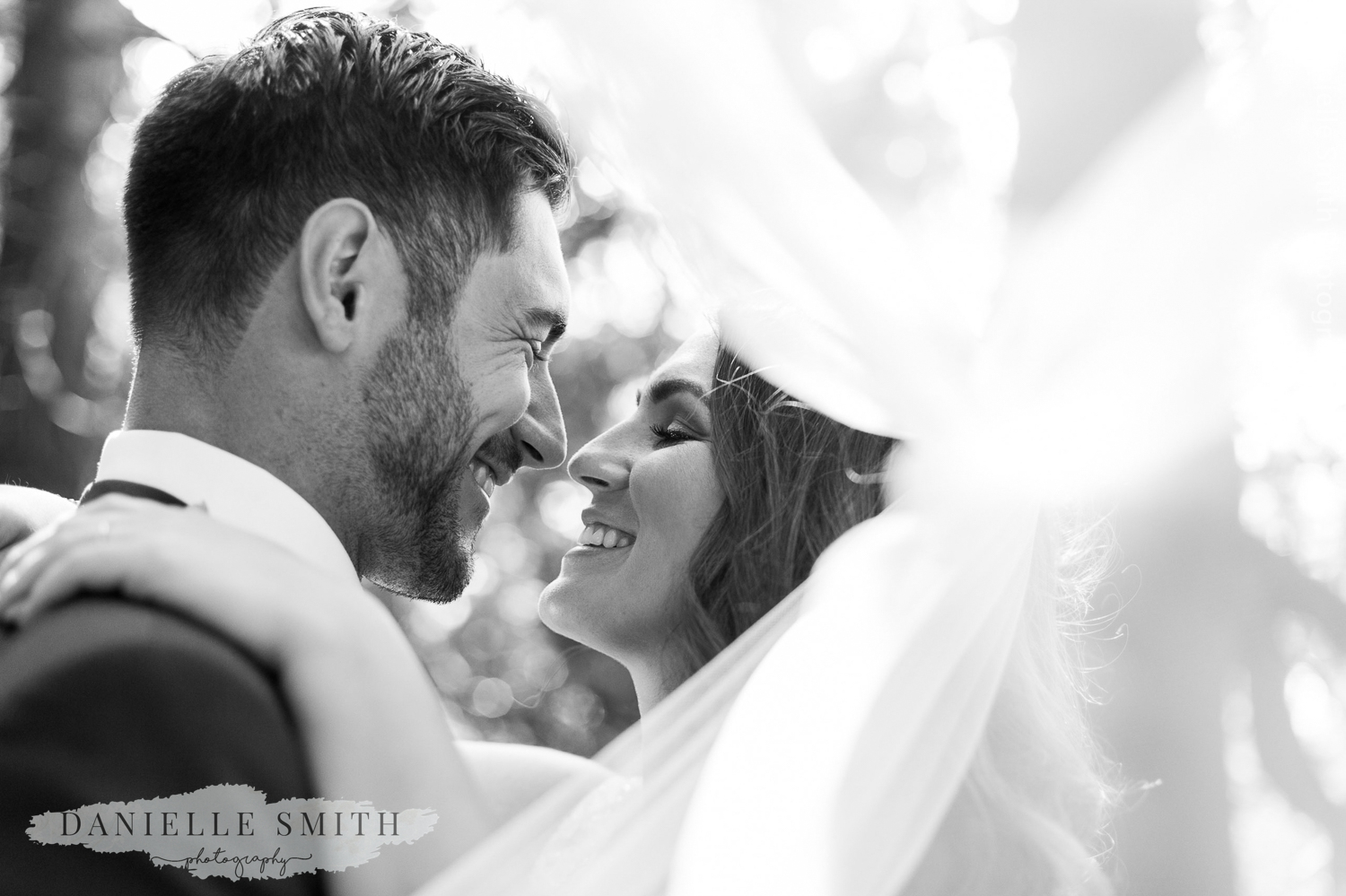bride and groom with veil blowing