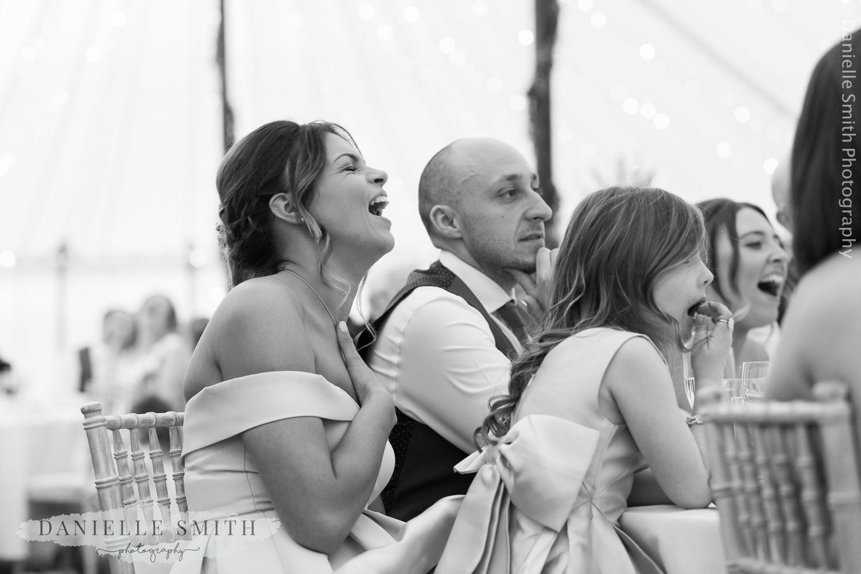 bridesmaid laughing at speeches - ingatestone hall wedding