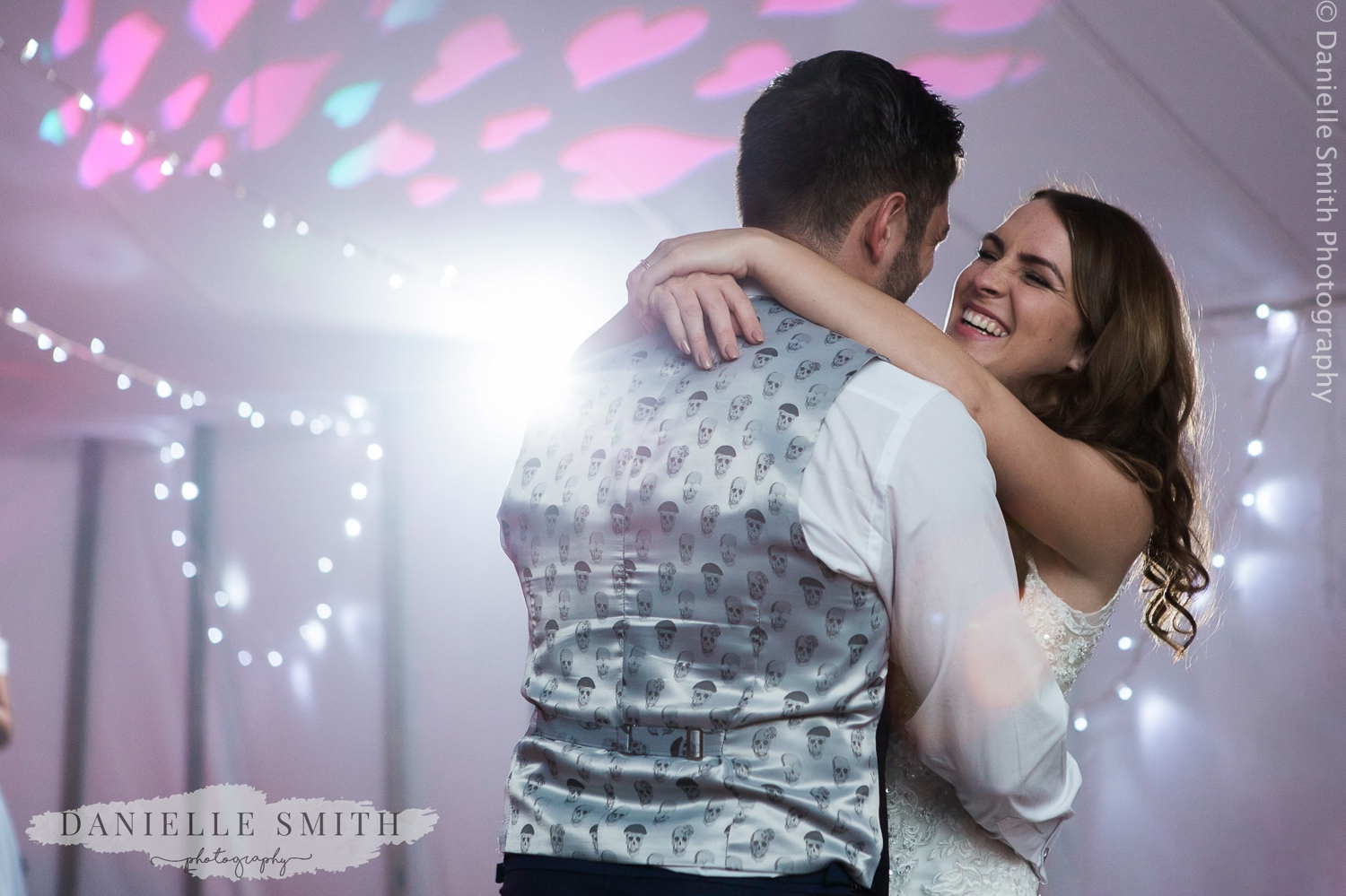 bride and grooms first dance in marquee wedding