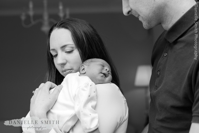 mum and dad with newborn baby - natural newborn photography