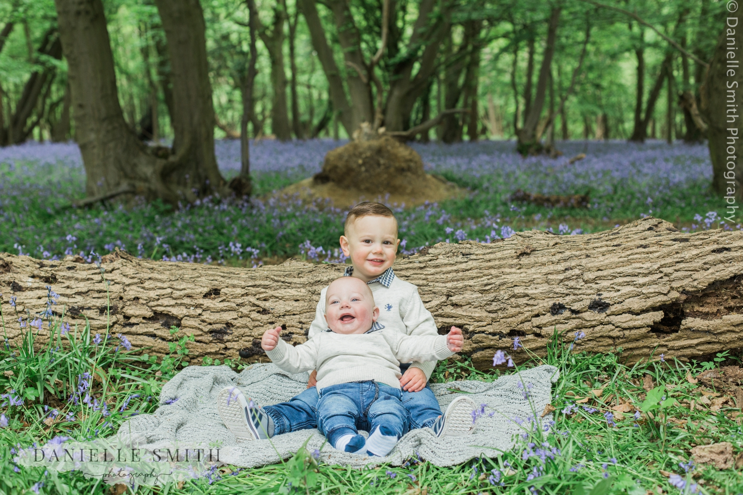 young brothers hugging in bluebells photo shoot