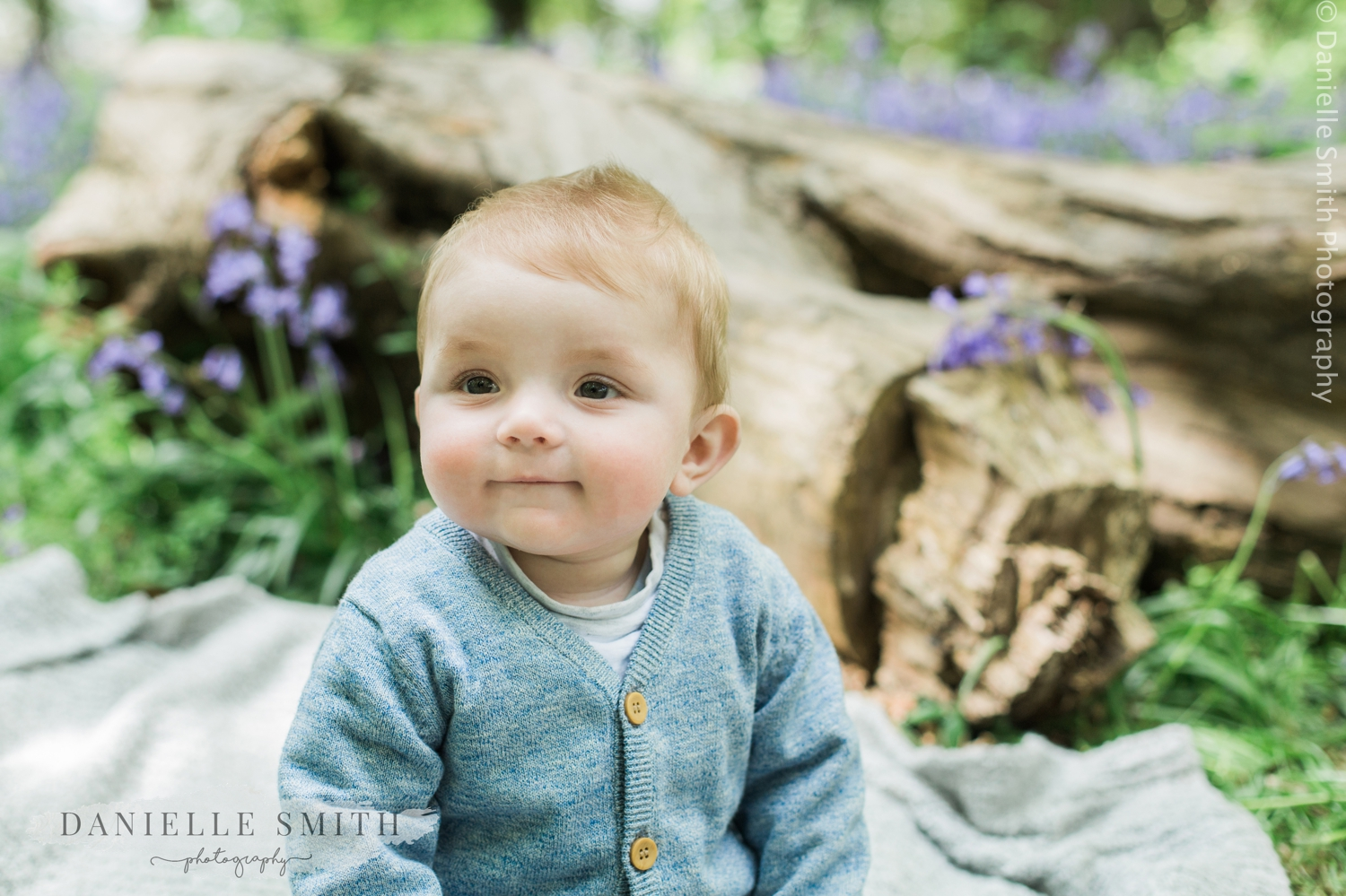 close up of baby boy in bluebell woods