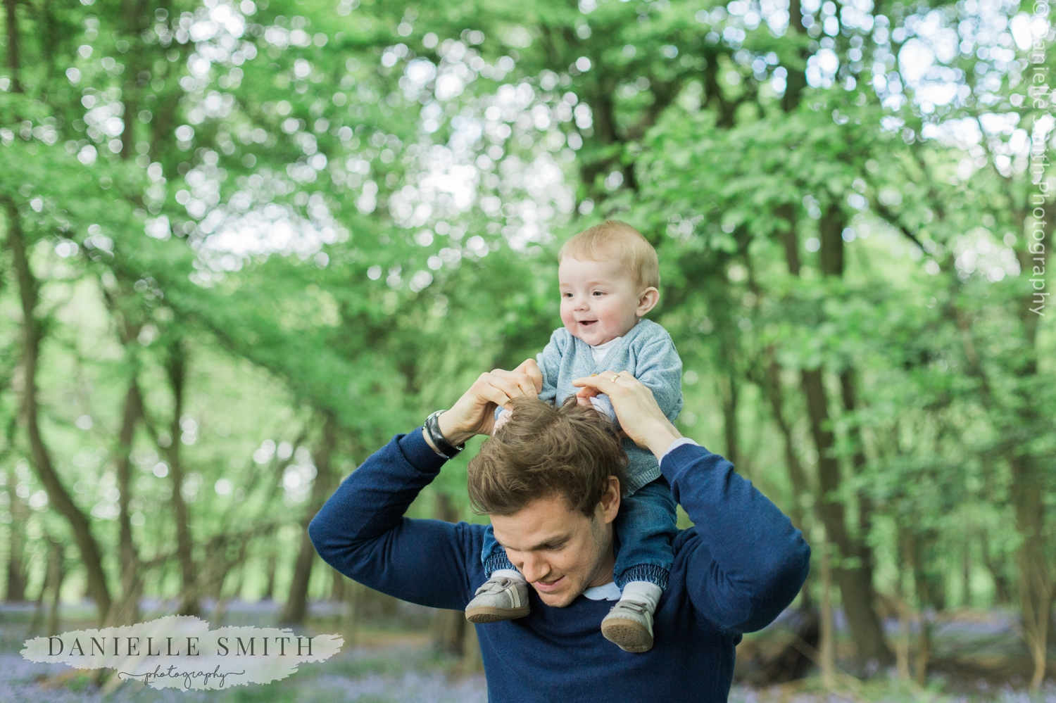 baby boy on dads shoulders