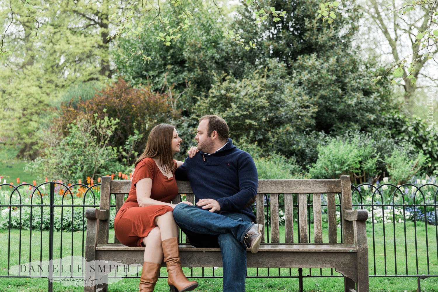 couple sitting on bench in London park