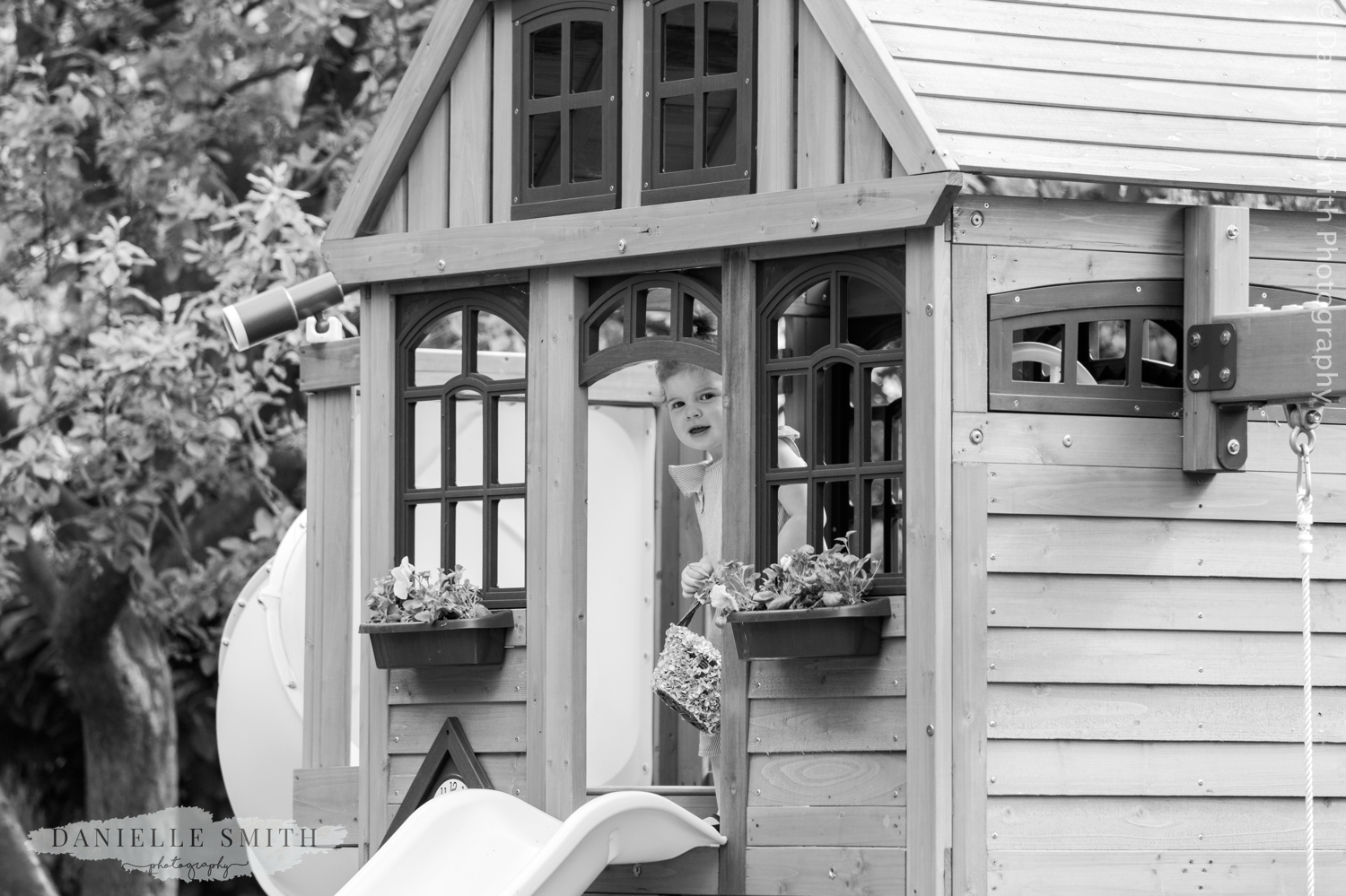 little girl peeking out of her play house