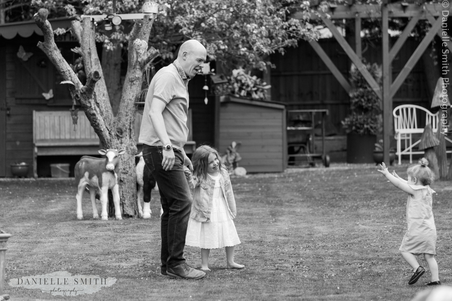 niece playing with her uncle in garden