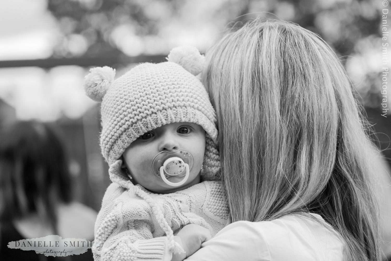 baby boy with teddy bear hat on