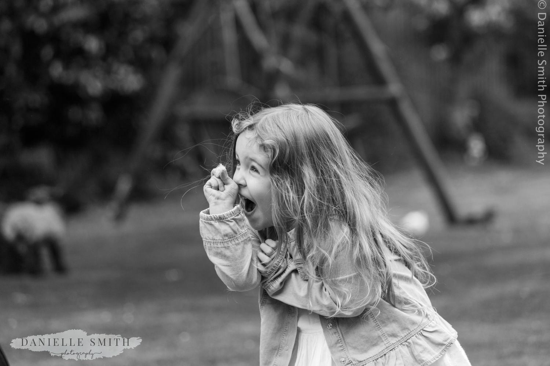 little girl picking flowers in garden