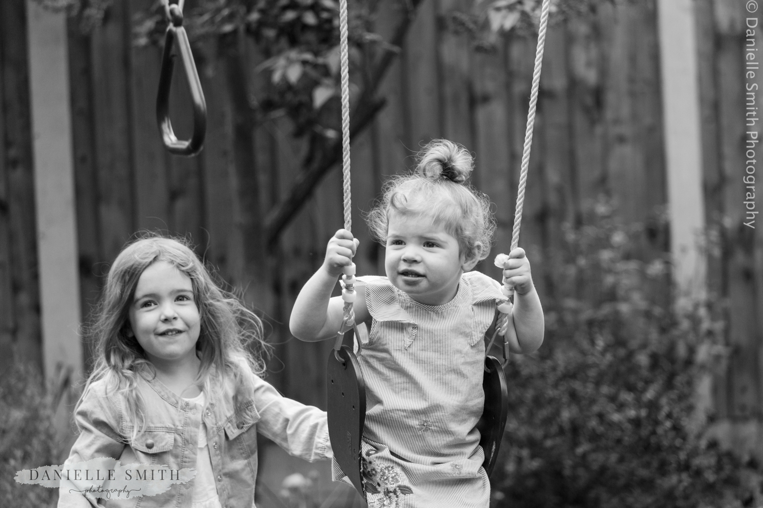 cousins playing on swings together