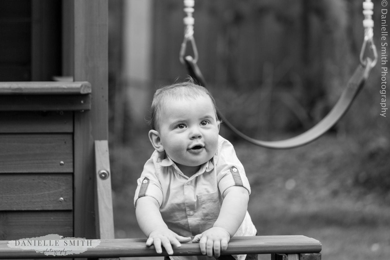 little boy standing up in garden
