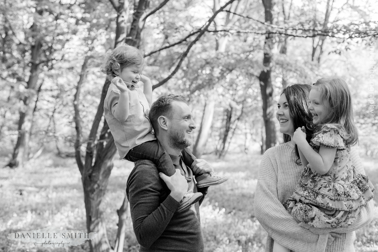 family having fun in forest
