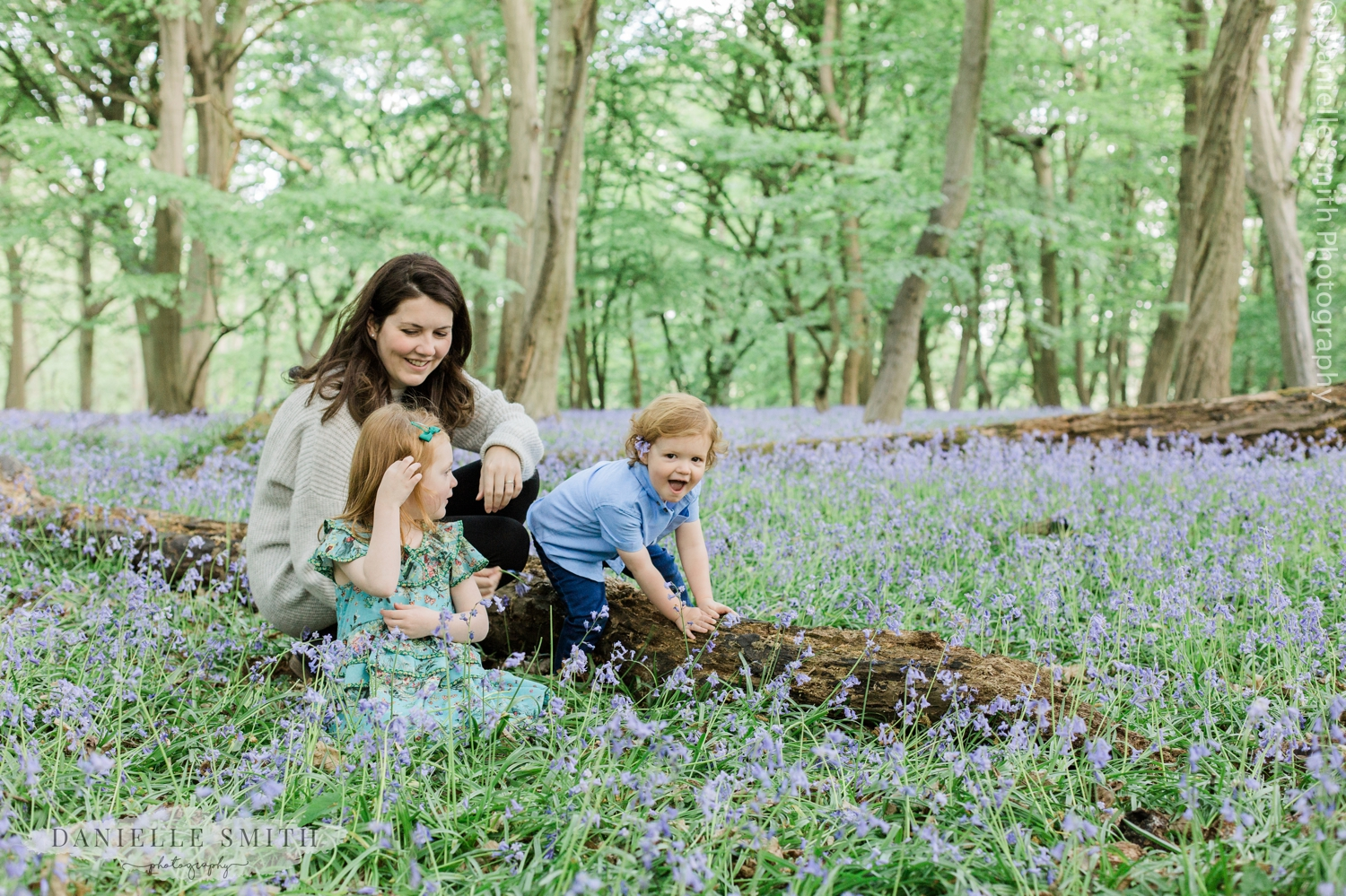 kids playing with mum in bluebell woods