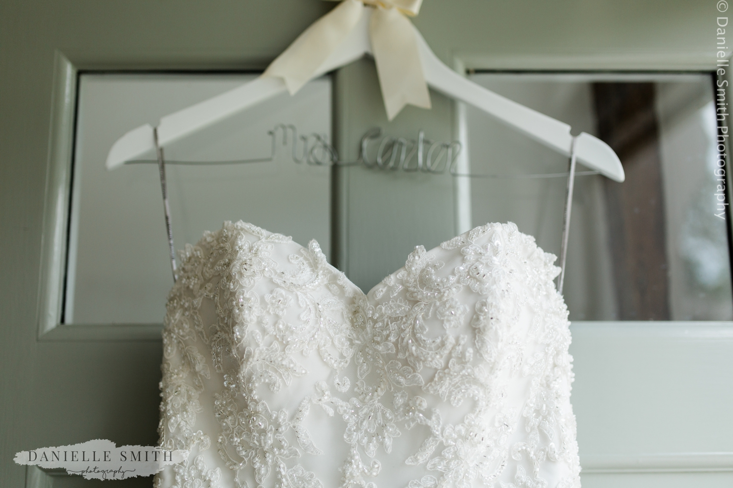 wedding dress hanging on front door